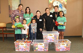 Schatz Orthodontics team and Cibolo Green Elementary School students collecting sweets for Soldiers' Angels.