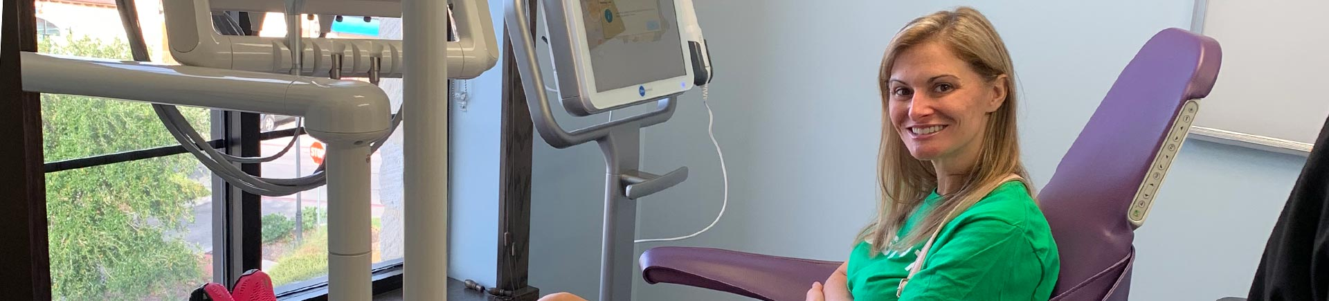 satisfied woman in a dental chair at A patient in a dental chair at Schatz Orthodontics