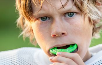 Child With Mouthguard for Sports